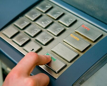 Typing a pin number into a chip and pin machine Stock Photo - 3384038