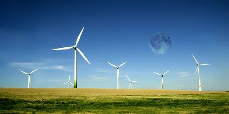 Wind turbines farm with full moon. Alternative energy source.  photo