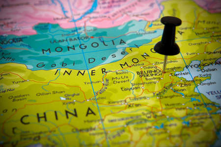 Small pin pointing on Beijing (China) in a map Asia. Stock Photo