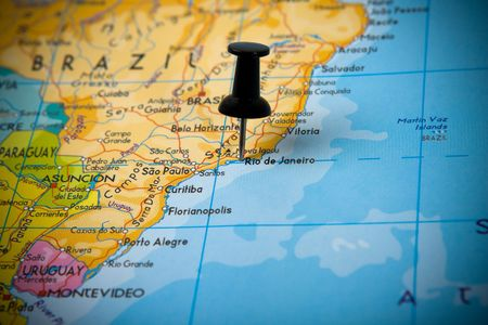 Small pin pointing on Rio de Janeiro (Brazil) in a map of South America  Stock Photo