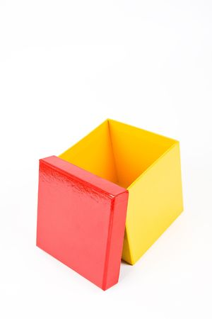 tokens: Opened yellow gift box with red cap. Stock Photo