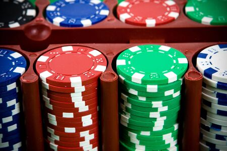 Poker chips in a box. Close-up. photo