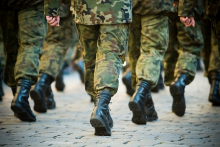 war and military: Soldiers march in formation Stock Photo