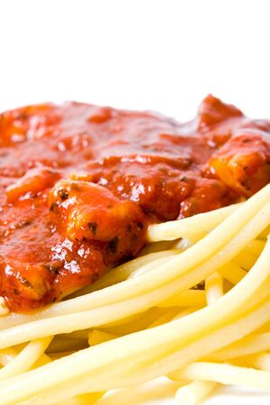 Spaghetti in a white plate on white background