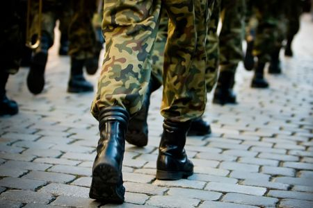army man: Soldiers march in formation Stock Photo