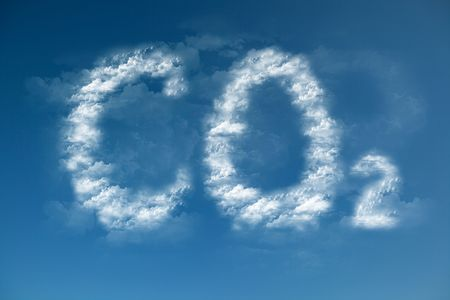 Clouds form a CO2 symbol - global warming Stock Photo
