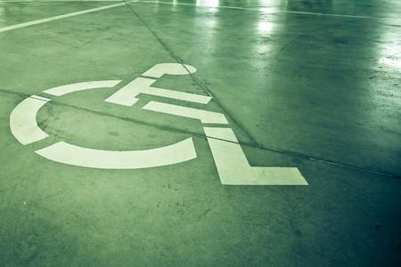 Disability sign on grunge background photo