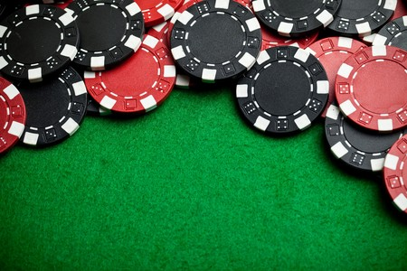 Red and black gambling chips photo