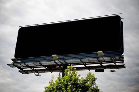Black blank advertising billboard over sky photo