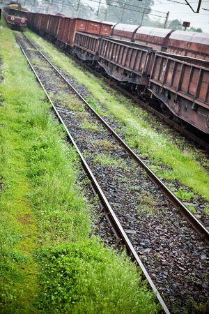 flatcar: Cargo wagons in the train station during rain