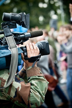 News maker on reportage recording with camcode Stock Photo - 7823595