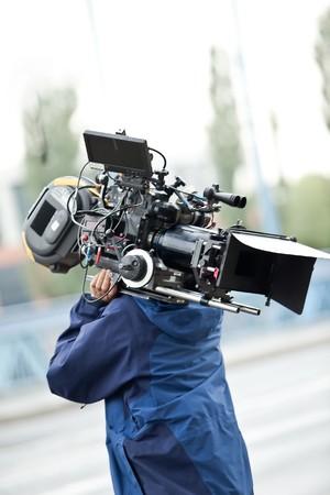Camera operator carrying equipment