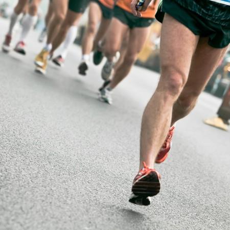 running race: People running in city marathon