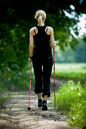 Nordic walking in summer nature