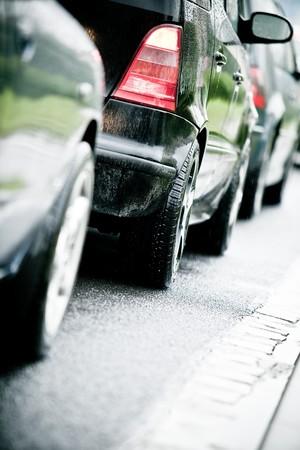 Traffic jam in flooded highway cause rain photo