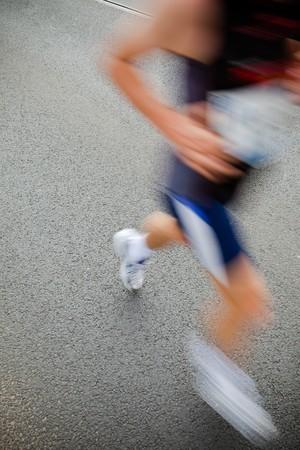 Man running in city marathon - motion blur Stock Photo