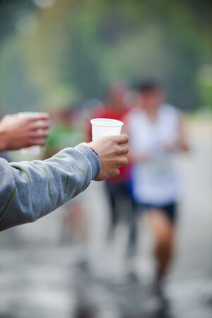 isotonic: Runner take a water in a marathon race Stock Photo