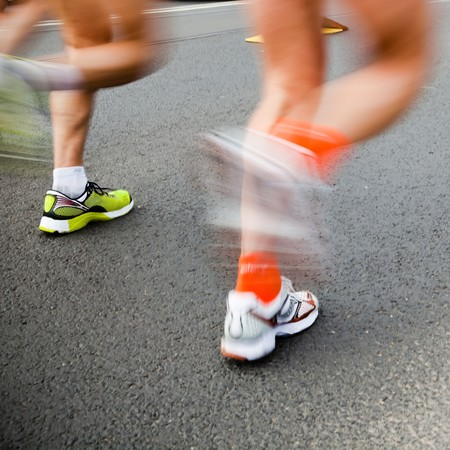 Man running in city marathon - motion blur Stock Photo - 7922447