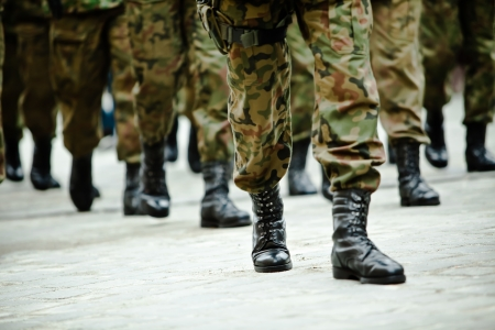 Soldiers of the armed forces marching  photo