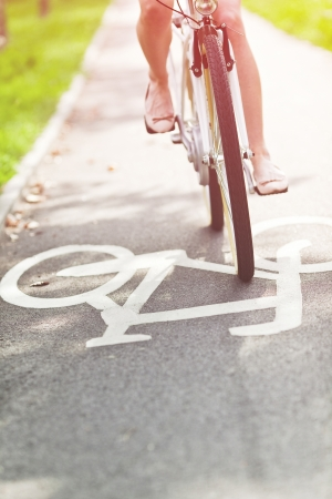 fast lane: Blurred woman riding bicycle on a bike path