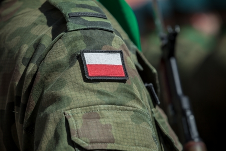 special service: Flag patch on polish soldier uniform