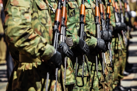 Military force uniform soldiers standing in a row