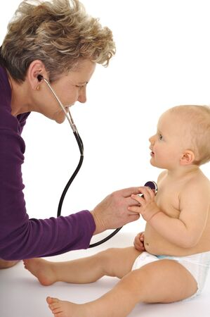 examined: brave baby and nice doctor Stock Photo