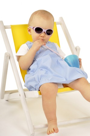 funny little girl in sunglasses on little yellow deck chair photo
