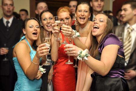young girls are making cheers mate on the party photo