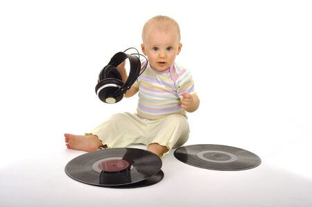 sweet little baby is trying to be a dj photo
