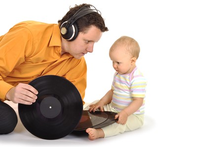 Dad with baby is playing and listening music photo