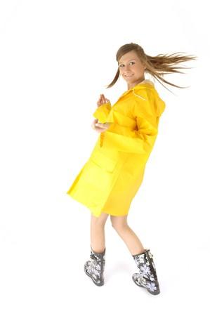 happy and beautiful woman in yellow raincoat on rainy day photo