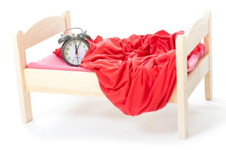 smal: smal clock in small bed on white background Stock Photo