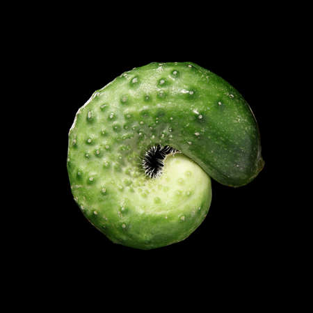 The green cucumbers isolated on black background Stock Photo