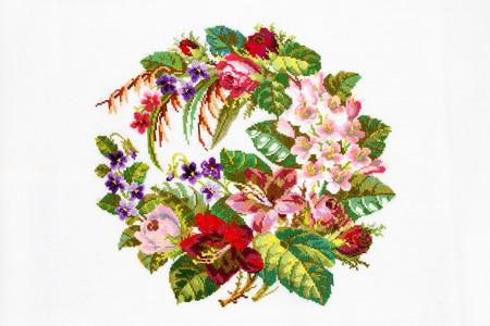 embroidered by cross-stitch pattern; ukrainian ethnic ornament 免版税图像