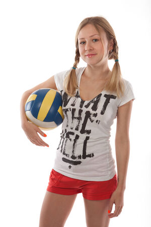 sportingly: Girl holding volleyball ball isolated on white