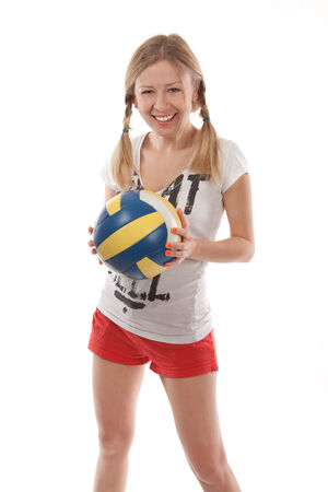 sportingly: Happy female volleyball player holding ball on white background