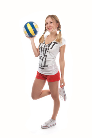 sportingly: Happy female volleyball player holding ball on white