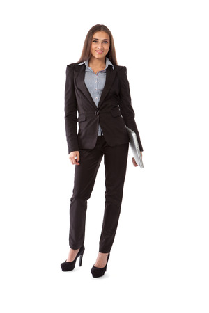Business woman with laptop standing in full length isolated on white