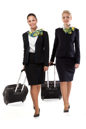 stewardess with luggage bags after the flight Stock Photo