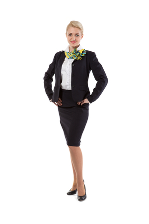 Full body flight attendant standing isolated on a white photo