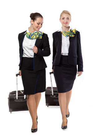 stewardess with luggage bags after the flight 版權商用圖片