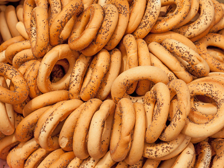 background of bagels with poppy seeds