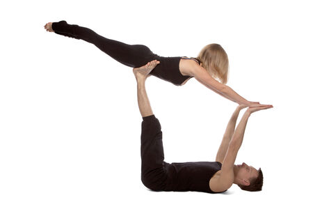 Man and woman doing yoga on white background photo