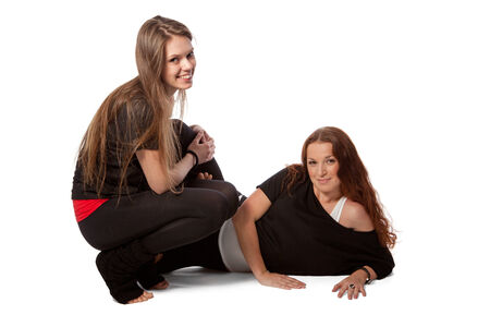 Two girls relaxing in a yoga photo