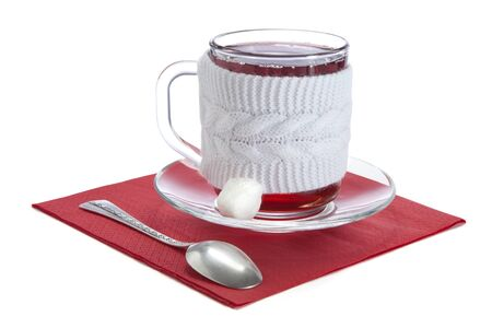 reflectance: glass cup with red tea in a white sweater