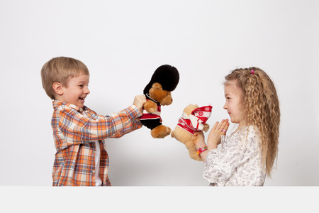 brother sister fight: The boy and the girl play and quarrel Stock Photo