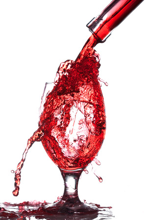 bleb: Splash of wine in the cup filling on a white background Stock Photo