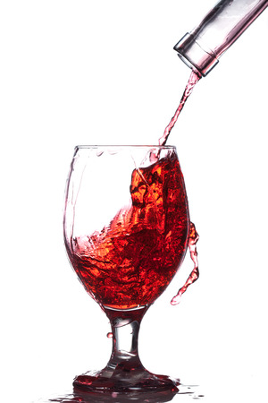 glee: Splash of wine in the cup filling on a white background Stock Photo