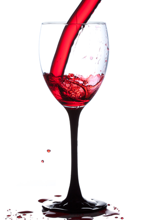 gleeful: Splash of wine in the cup filling on a white background Stock Photo